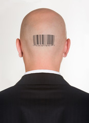 Male's back of head with printed barcode on it