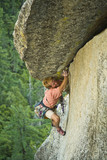A rock climber makes his way up a crack on Suicide Rock. poster