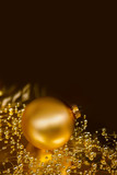Lustrous golden ornaments with dark background poster