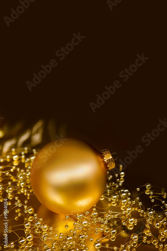 Lustrous golden ornaments with dark background