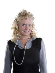 A woman with curly blonde hair in a grey and black suit