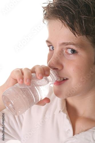young boy drinking water vertical upclose