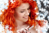picture of lovely redhead with scissors and snowflakes - 9469826