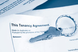 some paperwork concerning tenancy agreement with key poster