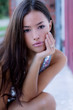 beautiful young woman portrait, outdoor in dusk, blurred