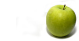 A ripe granny SMith apple over a plain white background poster