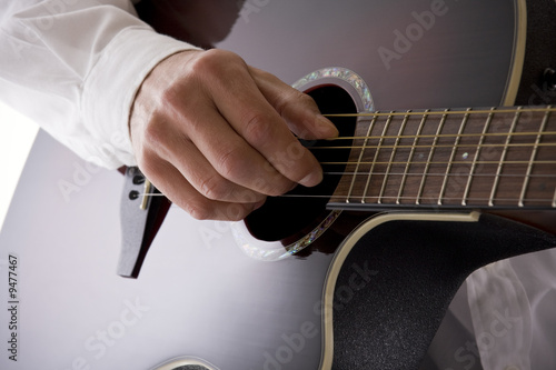 High key acoustic guitarist with copy space