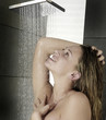 Portrait of beautiful woman having shower