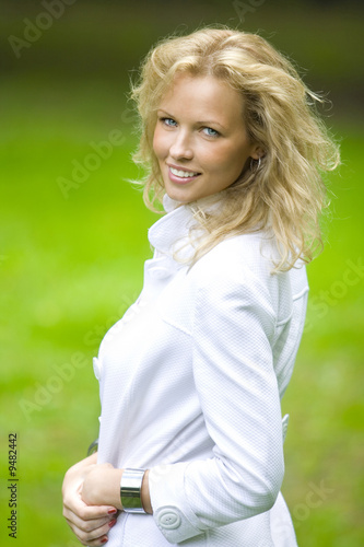 smiling blonde woman in park