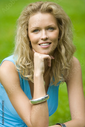 smiling blonde beautiful woman in the park