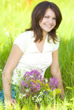 Fototapety laughing girl with bunch on grass