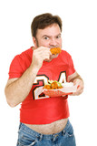 Overweight mature man chowing down on chicken wings. poster