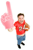 Enthusiastic football fan holding a football and foam finger. poster