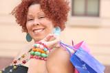 Plus size model, smiling about a purchase, shopping bags poster