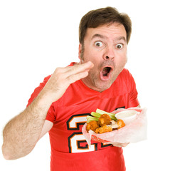 Football fan shocked by how hot his buffalo wings are.