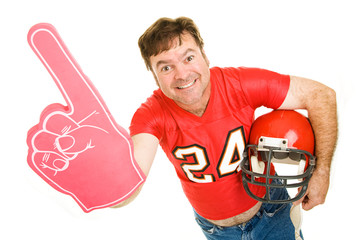 Middle aged football fan wearing his old high school jersey