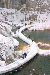 Plitvice - winter landscape with lake, path and some tourists