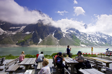 Tourists enjoying the view at lake Moserboden in Kaprun