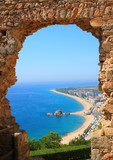Blanes beach view through an arch  (Costa Brava, Spain)