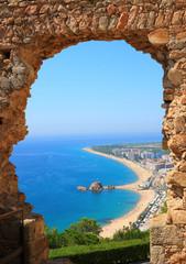 Blanes beach view through an arch  (Costa Brava, Spain)