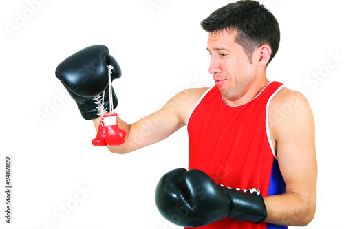 boxer looks at small gloves