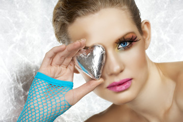 Blond beautiful woman with blue eyes and fashion make-up