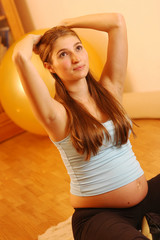 A pregnant young woman doing exercises