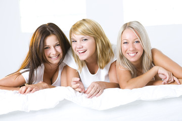 Three girls in bed