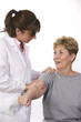 physical therapist talks to a patient