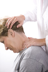 physical therapist examines a patient's neck