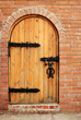 Wooden doors with lock and brick