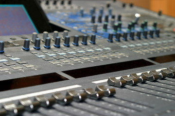 Top view of a mixing console in a music studio