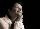 Beautiful woman gazing up in joyful contentment, sepia toned poster