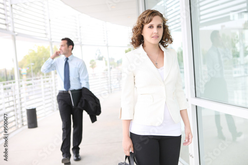 A young, pretty business woman at office building to work