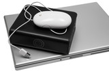 notebook and an external hard drive on a white background poster