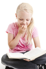 Young girl reading funny book over white background