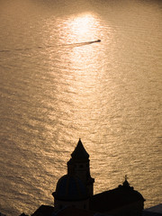 church of Saint Gennaro to the sunset on the sea in Praiano