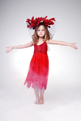 Gorgeous little girl in red Halloween dress.