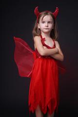 Beautiful little girl posing in evil Halloween costume.