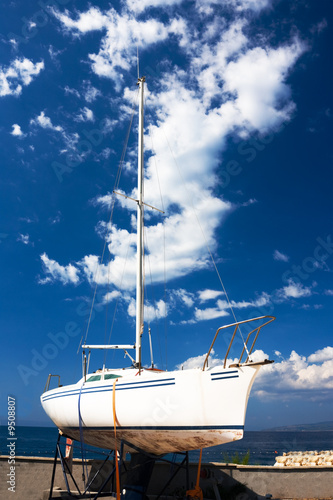 white yacht against blue sky