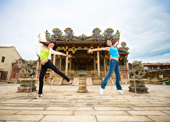 two asian girls friend jumping happily