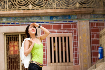 asian young woman looking around at the heritage site