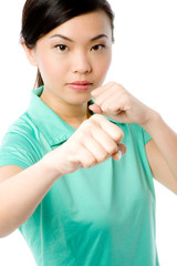 A young attractive Asian woman in green sports top