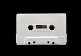 White audio cassette isolated on black background