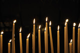 Candles in catholic church on dark background poster