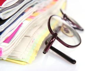 Eyeglasses and newspapers