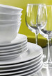 Stack of Commercial White Plates Bowls and Wine Glasses - 9523660