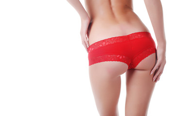 beautiful hands and buttocks of young woman in red lasy panties