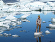 Man, standing barefoot on ice in Jokulsarlon lagoon, Iceland