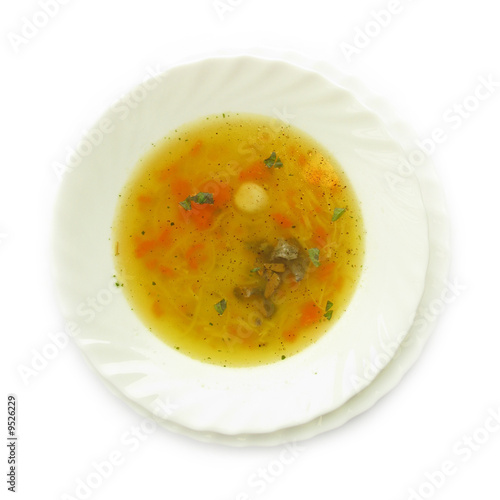 Chicken soup with carrot, liver and basil leaves